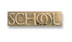 Figure 12: The word SCHOOL on the original 1922 medal.